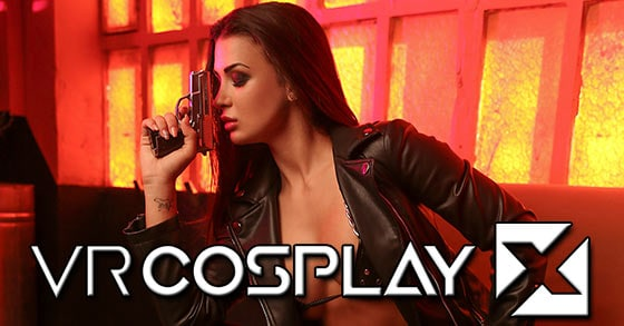 Susy Gala wearing leather motorcycle jacket and studded bra posing with handgun VR Cosplay X Grand Theft Swallow parody